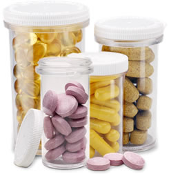 image of clear prescription bottles filled with medicine tablets and capsules