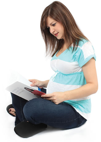 Expecting mother reading birth class education material